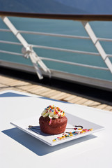 Alaska - Delight With A Cupcake On The Deck Of Cruise Ship