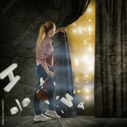 young woman pushes the curtain