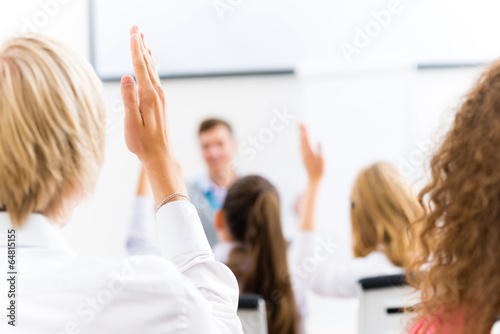 male hand raised in class