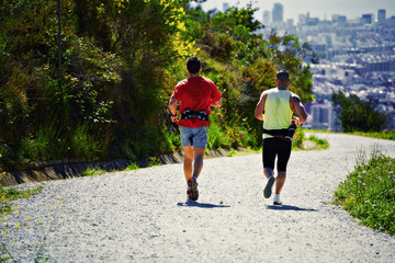 boys running and enjoying the panorama of the city,