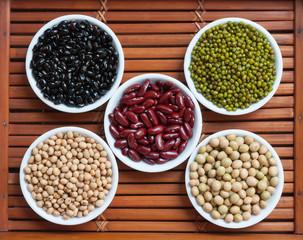 Five colored beans in ceramics bowl