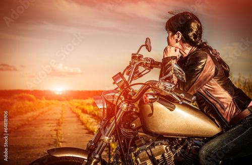 Biker girl on a motorcycle - 64818906