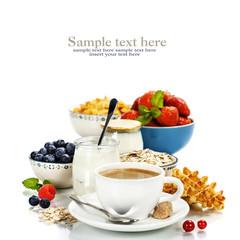 Healthy breakfast - yogurt, coffee, muesli and berries