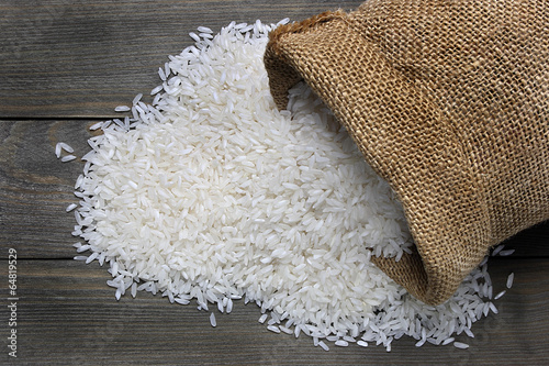 Raw rice in canvas sack - 64819529