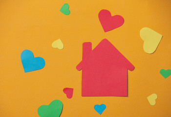 paper house on yellow background