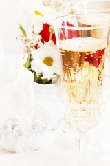 champagne with wedding flowers