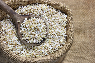 Pearl barley in canvas sack