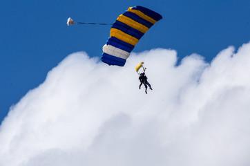 Tandem Parachutists against cloud