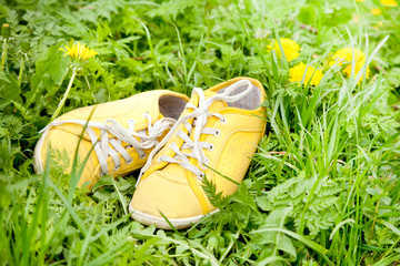 yellow sneakers on green grass, spring walk