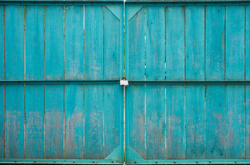 Wooden gates with padlock