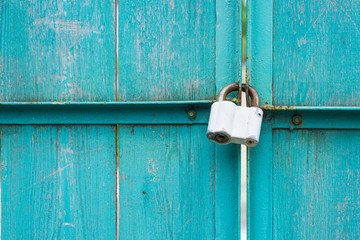 Closeup of wooden gate with padlock
