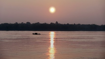 Small boat fish at sunrise , Cambodia