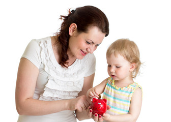 happy mother and kid put coins into daughter's piggybank