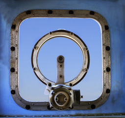 old military war ship window against blue sky background use for