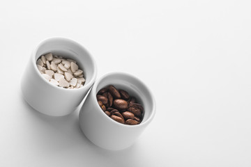 Set of saucers filled with coffee beans and sweet candy
