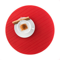 Cup of coffee and red mat