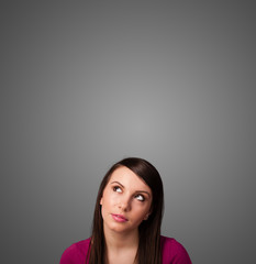 Thoughtful young woman gesturing with copy space