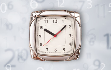 Modern clock with numbers comming out