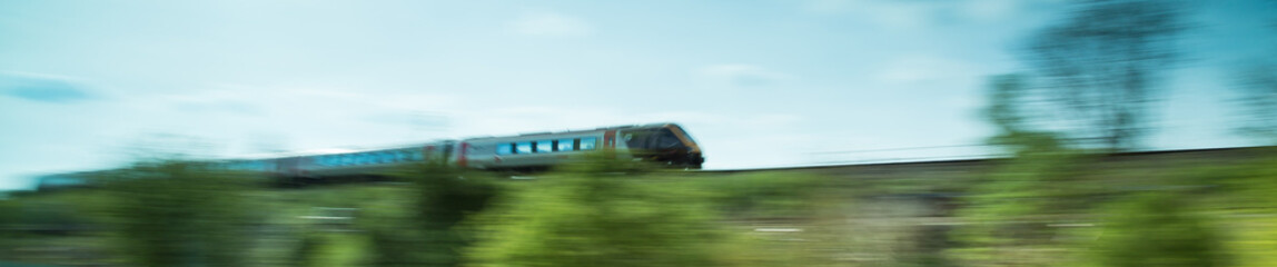 Train speeding passed in the countryside