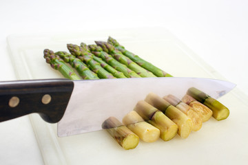 Cooked asparagus , cutting off stalk ends