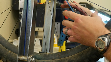 Repairman at Work in Bicycle / Bike Shop 2 (Close Up)