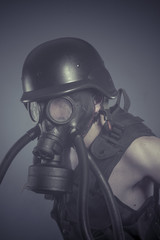 Factory, Man with black gas mask, pollution concept and ecologic