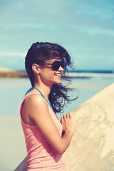 smiling female surfer