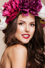 beautiful happy woman with bright flowers on her head and red
