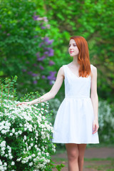 Redhead girl in the garden.