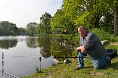 canvas print picture Fisherman with fishing rods