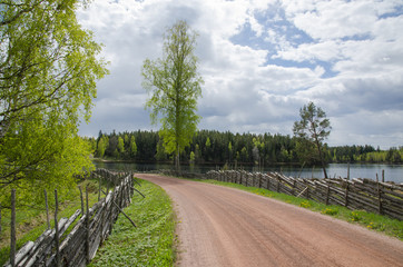 Old gravel road by the lake