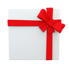 perfectly wrapped white gift witth red ribbon