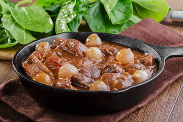 goulash meat in a frying pan