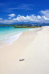 Beach on Gili Trawangan island with yellow boats