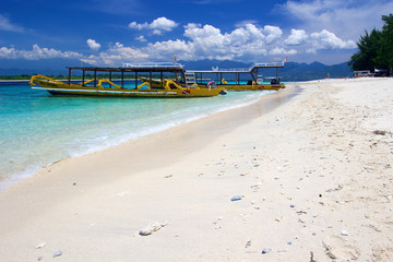 Yellow boats on beach on Gili Trawangan island