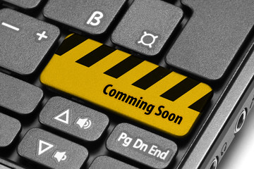 Comming Soon. Yellow warning key on computer keyboard