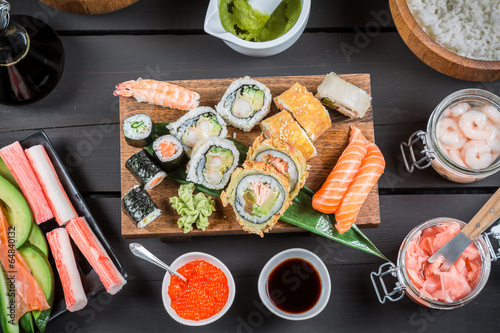 Sushi surrounded by fresh ingredients - 64840132
