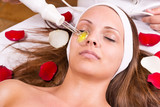 Ozone treatment on face at the beautician. poster