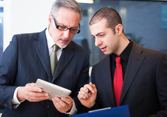 Business people using a tablet