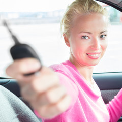 Woman driver showing car keys.