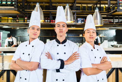 Asian chefs cooking in Restaurant - 64841962