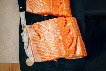 Fresh raw salmon preparation - seen from above in modern kitchen