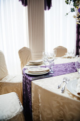 Wedding reception table setting in modern venue restaurant