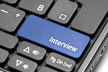 Interview. Blue hot key on computer keyboard