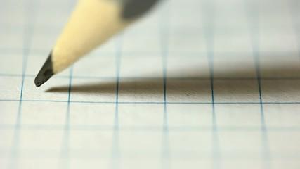 Pencil broken in writing in a notebook.