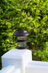 New solar lamp mounted on deck post outdoors