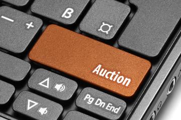 Auction. Orange hot key on computer keyboard
