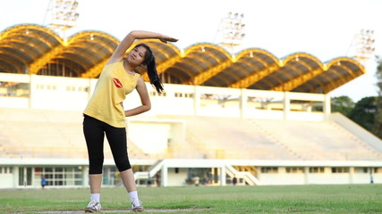Woman warm up before running at sport stadium
