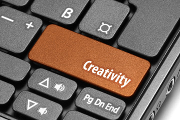 Creativity. Orange hot key on computer keyboard