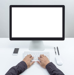Man hand on desktop keyboard with blank screen monitor